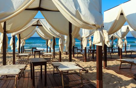 Luxury beach tents canopies on morning paradise white sandy beach Maldives of Salento (Pescoluse, Salento, Puglia, south Italy). The most beautiful sea sandy beach of Apulia. Standard-Bild