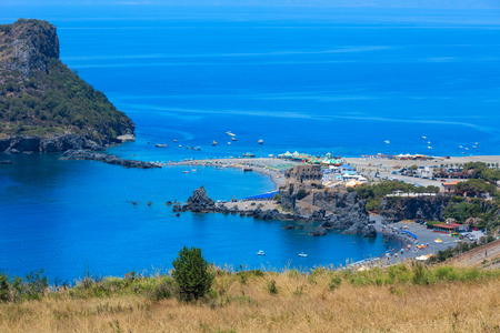 Beautiful Calabrian Tyrrhenian sea coastline landscape, small rocky island Isola di Dino and Torre di Fiuzzi, Praia A Mare, Calabria, Italy. People unrecognizable.