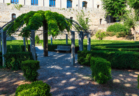 Green garden with geometric shades near Montepulciano Fortezza Medicea (Fortezza Di Montepulciano). Province of Siena, Tuscany, Italy. Stock Photo