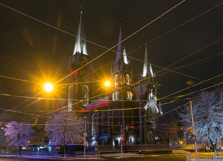 Beautiful illuminated night winter Church of Sts. Olha and Elizabeth in Lviv, Ukraine. Built in the years 1903-1911. Some lens flare flrom lamps available. Signs unrecognizable.