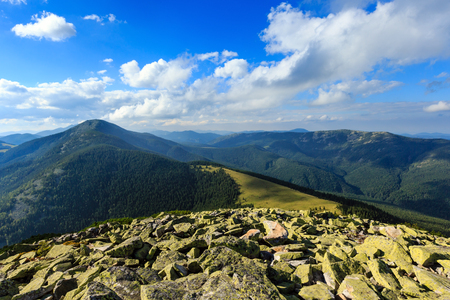 Summer Carpathian mountain top view from stony summit of Homiak Mount (Gorgany, Ukraine).