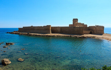 Aragonese castle of Le Castella, a fortress on a small islet on Ionian Sea coast, overlooking the Costa dei Saraceni near Capo Rizzuto, Calabria, Italy.