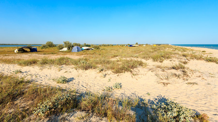 Self-dependent camping in sandy prairie between Ustrychne lake (Oyster lake) and Azov sea (Lazurne, Kherson Region, Ukraine) Stock Photo