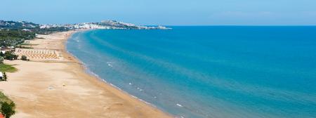 Summer Lido di Portonuovo Adriatic sea beach view (Vieste, Gargano peninsula, Puglia, Italy). People are unrecognizable. Two shots stitch panorama.
