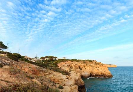 Evening Atlantic rocky coastline landscape (Lagoa district, Algarve, Portugal). Stock Photo