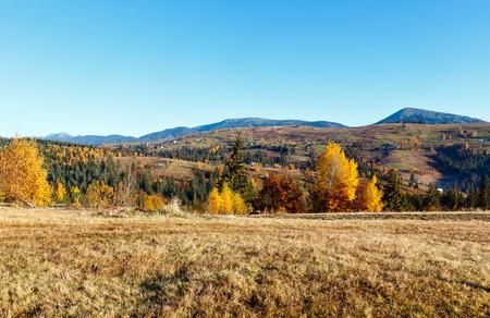 Morning Carpathian mountains and village hamlets on slopes (Yablunytsia village and pass, Ivano-Frankivsk oblast, Ukraine).