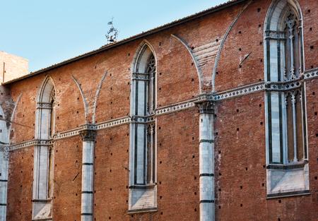 Summer Siena italian medieval town street scene, Siena province, Tuscany, Italy. Stock Photo