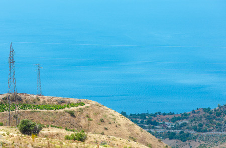 Picturesque summer view to sea from mountain hills in Motta San Giovanni outskirts, Reggio Calabria, Italy. Stock Photo