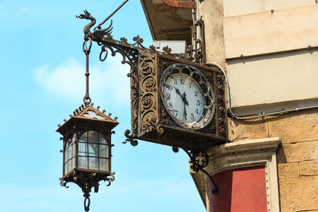 Beautiful old clock on house corner in Florence, the capital city of Tuscany region, Italy.