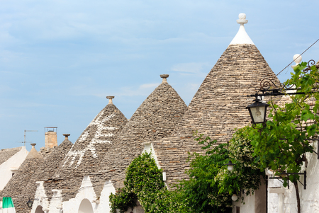 Trulli houses roofs in main touristic district of Alberobello beautiful old historic town, Apulia region, Southern Italy