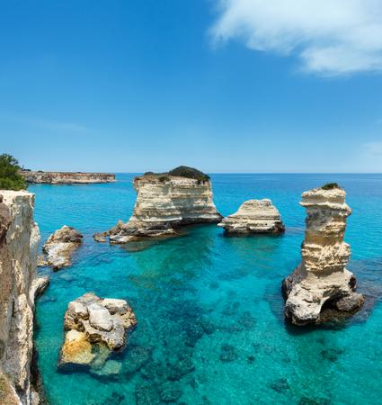 Picturesque seascape with cliffs and stacks (faraglioni), at Torre Sant Andrea, Salento sea coast, Puglia, Italy. Two shots stitch image.