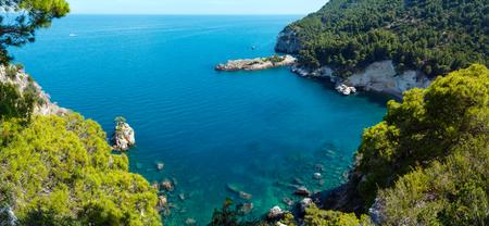 Summer calm beautiful beach Cala di Porto Greco on the Gargano peninsula in Puglia, Italy. View from Torre dell Aglio. Two shots stitch panorama.     版權商用圖片
