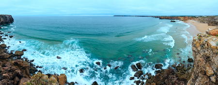 Atlantic ocean coast view from windswept point (Sagres, Algarve, southern Portugal). Two shots stitch panorama.   Stock Photo