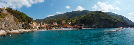 Beautiful summer Monterosso view from excursion ship. One of five famous villages of Cinque Terre National Park in Liguria, Italy. People unrecognizable. Stockfoto