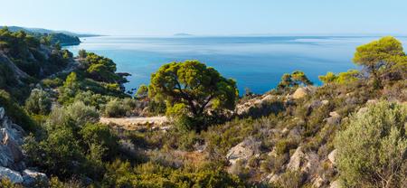 Morning summer Aegean Sea coastline (Nikiti, Sithonia, Halkidiki, Greece). Two shots stitch panorama.