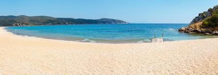 Wonderful sandy beach at Aegean sea on Sithonia, Halkidiki, Greece. Two shots stitch high-resolution panorama. Stock Photo