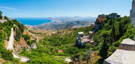 Panoramic view to Tyrrhenian coastline with Cofano mount, Church of Saint John the Baptist and Torretta Pepoli from Erice town, Trapani region, Sicily, Italy