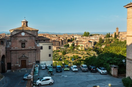 Siena, ITALY - JUNE 23, 2017: Summer medieval town street scene, UNESCO World Heritage Site, Siena province, Tuscany.