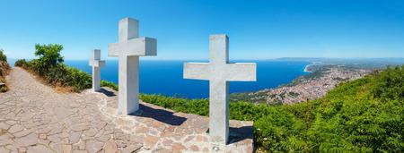 Summer picturesque Tyrrhenian sea Calabrian coast view from Monte Sant'Elia (Saint Elia mount, Calabria, Italy) top. Three Christianity crosses on mountain top.