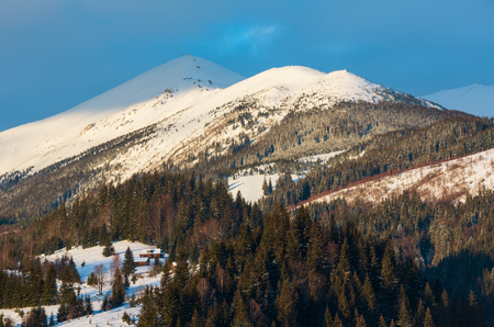 Sunrise morning winter snow covered scenery picturesque alp mountain ridge (Ukraine, Carpathian Mountains, Chornohora Range, tranquility peaceful Dzembronya village outskirts). Reklamní fotografie