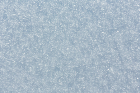 Structure of beautiful calm sunny outdoor snow surface with crystalline snowflakes (nature macro background, beautiful for winter concepts)