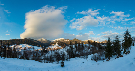 Sunrise morning winter scenery picturesque alp mountain ridge (Ukraine, Carpathian Mountains, Chornohora Range). Tranquility peaceful view from Dzembronya village rural snow covered path.