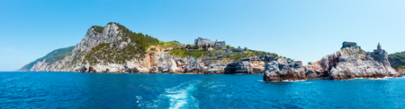 Beautiful medieval fisherman town of Portovenere (UNESCO Heritage Site) view from sea (near Cinque Terre, Liguria, Italy). Fortress Castello Doria. Imagens
