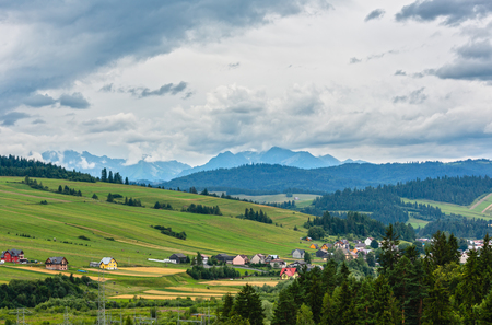Summer cloudy country and Tatra mountain view from Czorsztyn village, Poland.