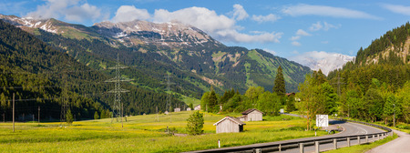 Summer Alps mountain valley panorama landscape from road, Austria.