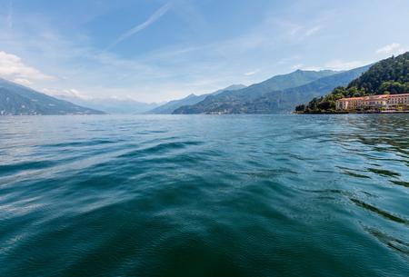 Lake Como (Italy) summer coast hazy view from ship board. Stock Photo