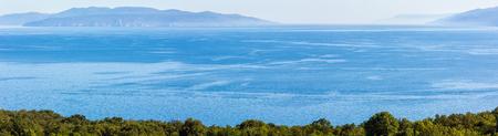 Hazy summer sea panorama with islands on horizon, Croatia. 版權商用圖片