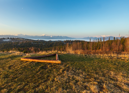 Early morning spring Carpathian mountains plateau landscape with snow-covered ridge tops in far, Ukraine. Stock fotó