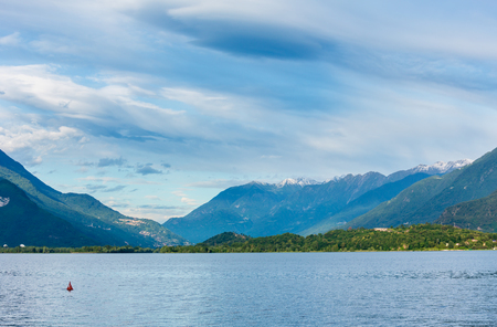 Lake Como (Italy) summer cloudy view with snow on mount top .