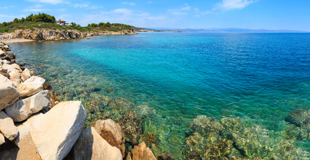 Summer Sithonia coastline and Aegean sea scenery with beach and house (Lagonisi, Halkidiki, Greece). Panorama.