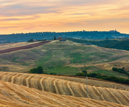 Beautiful landscape of Tuscany summer morning sunrise countryside in Italy. Stock fotó