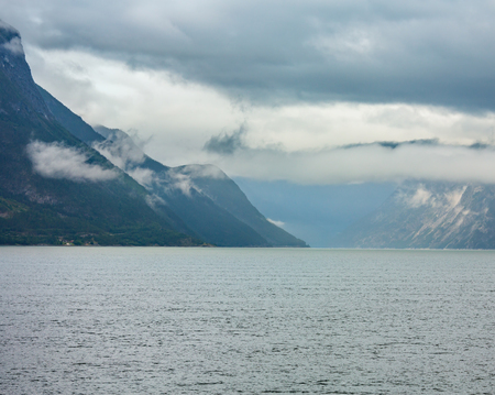 Beautiful summer cloudy evening fjord view, Norway