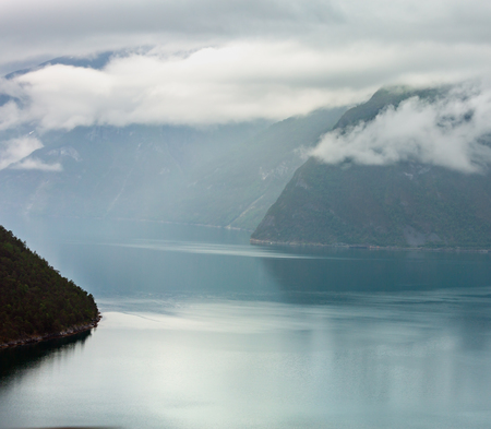 Beautiful summer cloudy evening fjord view, Norway.