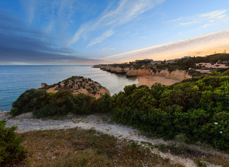 Beach Praia da Cova Redonda summer evening sunset view. Atlantic coast landscape (Lagoa, Algarve, Portugal).