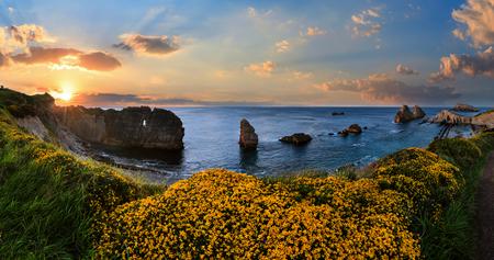 Blossoming Arnia Beach (Spain). Atlantic Ocean evening coastline landscape.
