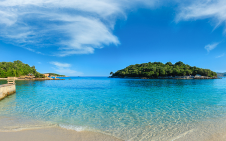 Beautiful Ionian Sea with clear turquoise water and morning summer coast. View from Ksamil beach, Albania. Banco de Imagens