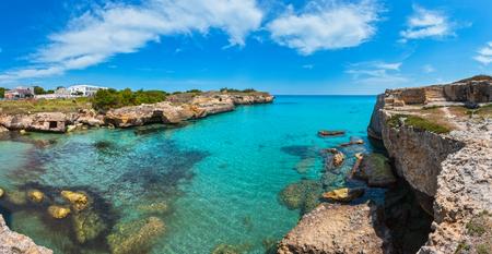 Ancient small caves on picturesque Adriatic sea coast Archaeological Area of Roca Vecchia, Salento, Puglia, Italy