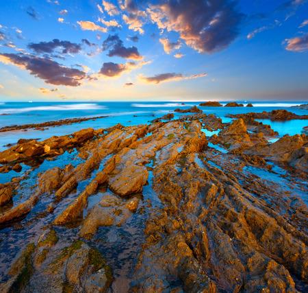 Twilight ocean coast with ribbed stratiform rock formations, Atlantic Ocean, Spain Фото со стока