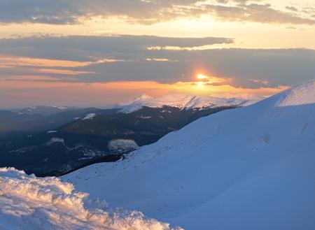 Sunset above winter mountain ridge, Ukraine, Carpathian.