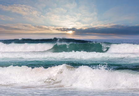 Sea storm with foam and splashes. View from beach.