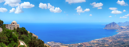 Panoramic view to Tyrrhenian coastline with Cofano mount and to Church of Saint John the Baptist from Erice town, Trapani region, Sicily, Italy. Multi shots stitch high-resolution panorama.