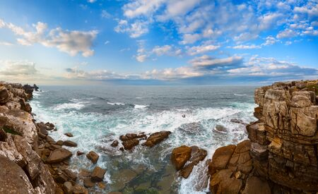 Summer Atlantic Ocean rocky coast sunset landscape in cloudy weather (Peniche, Portugal). Multi shots high-resolution panorama.