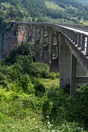 Djurdjevica Tara Bridge (opened in 1940, 172 meters above the Tara River) summer view, Montenegro. 写真素材