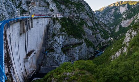 Mratinje Dam on Piva river canyon with its fantastic reservoir Piva Lake (Pivsko Jezero) summer view in Montenegro. Nature travel background. Banco de Imagens