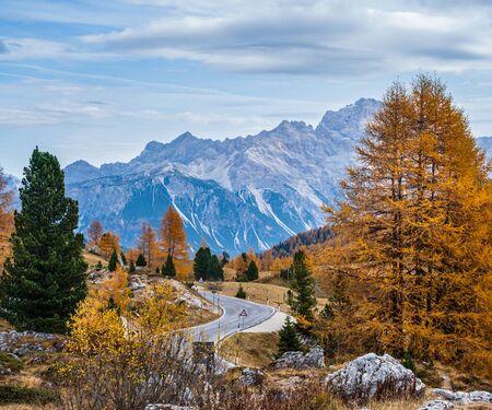 Overcast morning autumn alpine Dolomites mountain scene. Peaceful view near Valparola and Falzarego Path, Belluno, Italy. Picturesque traveling, seasonal, nature and countryside beauty concept scene. Stock fotó