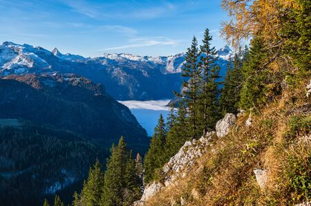 Autumn Alps mountain misty morning view from Jenner Viewing Platform, Schonau am Konigssee, Berchtesgaden national park, Bavaria, Germany.  Picturesque traveling, seasonal and nature beauty scene. Фото со стока - 139860962